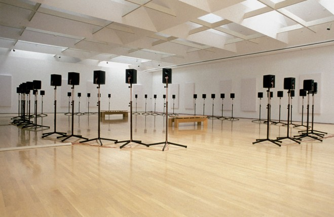 Text: Installation view of Janet Cardiff's Forty-Part Motet, 2001 40-track audio installation, 14 minutes in duration, at the Musée d'Art Contemporain, Montreal 2002. Courtesy of the artist and Luhring Augustine, New York.