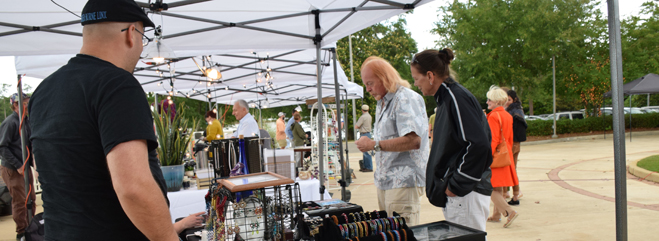 Text: Night Market is supported by funds awarded by the Mobile County Commission.