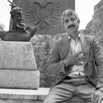 BESA: Enver Alia Sheqer with statue of Albania's national hero Skanderbeg, Photographer: Norman H. Gershman